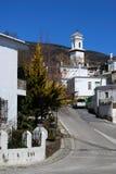 Chiesa in villaggio bianco, Pitres, Spagna. Immagine Stock Libera da Diritti