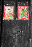 Chiese ancient wooden door with door-god picture Stock Photos