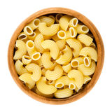 Chifferi pasta in wooden bowl over white Stock Image