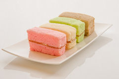 Chiffon cake. Colorful chiffon cake pieces with butter cream filled Stock Photo