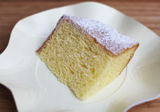 Chiffon cake piece dusted with sugar Stock Photos