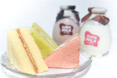 Chiffon cakes with two bottle of milk Royalty Free Stock Photography