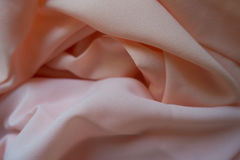 Chiffon fabric in pink and peach pastel colors Stock Photo