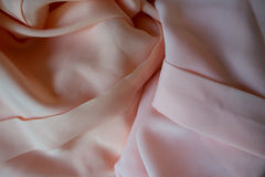 Chiffon fabric in pink and peach pastel colors Royalty Free Stock Photography