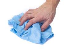 Chiffon pour les meubles de nettoyage dans le ménage sur le blanc photographie stock libre de droits