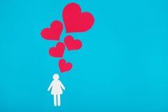 Chiffre de carton de femme sur un fond bleu Le symbole du lo Photos stock