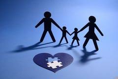 Chiffre de famille avec le coeur de puzzle denteux Photos libres de droits