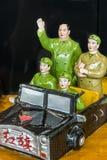 Chiffre de Mao Tse-Tung dans la voiture de jouet Photos stock
