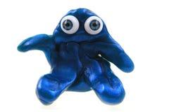 chiffre de pâte à modeler avec des yeux bleus d'isolement Photographie stock