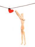 Chiffre en bois de la personne et coeur sur une corde avec un clothespe Image stock