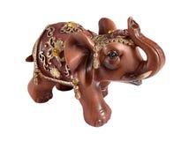 Chiffre en céramique d'un éléphant sur un fond blanc photo libre de droits