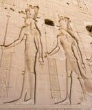 Chiffres égyptiens découpés sur le mur Images stock