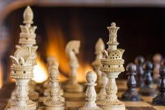 Chiffres d'échecs et le fond du feu Image libre de droits