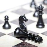 Chiffres d'échecs - stratégie et direction Photo stock