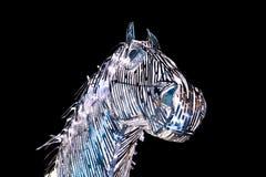 Chiffres de lumière de Noël Chiffre de cheval la nuit image stock