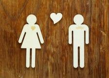 Chiffres en bois des hommes et des femmes Image stock