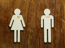 Chiffres en bois des hommes et des femmes Images libres de droits