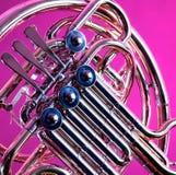 Chifre francês no fundo cor-de-rosa Imagem de Stock