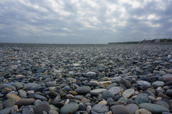 Beach of cobblestones. Stock Images