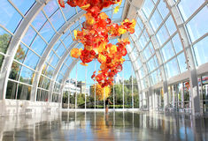 Chihuly Garden and Glass Museum, Seattle. SEATTLE, July 29, 2017: Chihuly Garden and Glass museum featuring one of Dale Chihuly`s largest sculptures suspended Stock Image