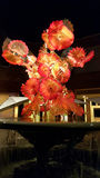 Chihuly Glass Sculpture in Red with Water Fountain Stock Photography
