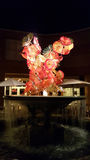 Chihuly Glass Sculpture in Red with Water Fountain Stock Images