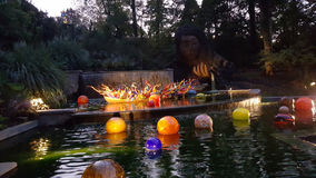 Chihuly Glass Sculpture in Water Feature at Night Stock Image