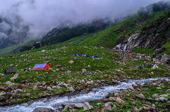 Chika campsite - Hampta pass trek. A view of Chika campsite with waterfall and stream. This is the first campsite for Hampta pass trek Royalty Free Stock Photo