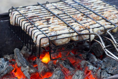 Chiken on the grill, fiery coals. Stock Photo