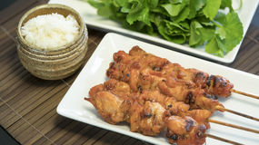 Chiken grilled sticky rice. Tasty grilled chicken turn golden brown and sticky rice Stock Photos