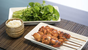 Chiken grilled sticky rice. Tasty grilled chicken turn golden brown and sticky rice Stock Images