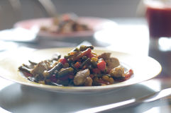 Chiken meat and vegetables on plate Stock Images