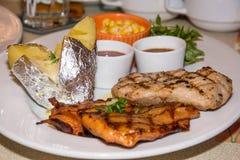 Chiken with pork chop Stock Photo