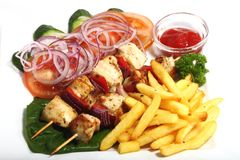 Chiken shish kebab with fried potatoes and vegetab Stock Images
