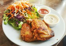 Chiken steak with salad and sauce. Chiken steak with salad and saucein white dish royalty free stock photos