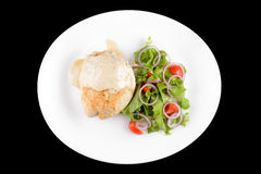 Chiken with vegetables on white plate Royalty Free Stock Images