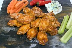 Chiken wings and condiments Stock Photos