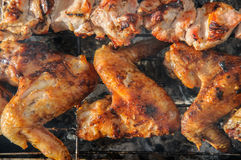 Chiken wings  and Juicy roasted kebabs and  on the BBQ Stock Photos