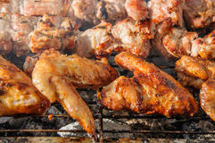 Chiken wings  and Juicy roasted kebabs and  on the BBQ Stock Image