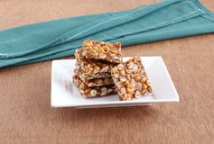 Chikki Indian Sweet in a Plate. Chikki, an Indian Sweet, is made from peanuts and jaggery or unrefined sugar stock image