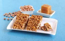Chikki Traditional and Popular Indian Sweet. Chikki, an Indian traditional and popular sweet, is made from peanuts and jaggery stock image