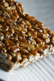 Chikki is a traditional ready-to-eat Indian sweet Royalty Free Stock Images