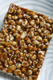 Chikki is a traditional ready-to-eat Indian sweet. Made usually from groundnuts and jaggery.There are several different varieties of chikki in addition to the Stock Photo