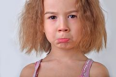Chil girl withred hair, discontent Stock Photo