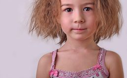Chil girl withred hair and shirt. Foto in stidio child girl, red hair, discontent stock photo