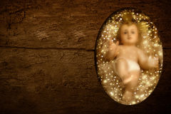 Chil Jesus wooden background Royalty Free Stock Images