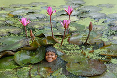 Chil's play. A girl playing in the lotus pond stock image