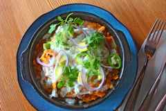 Chilaquiles mexican dish wooden table royalty free stock images