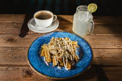Chilaquiles mexican food, nachos, chicken and cheese mexico city. Spicy breakfast Royalty Free Stock Images