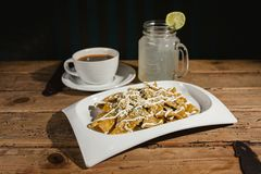 Chilaquiles mexican food, nachos, chicken and cheese mexico city. Spicy breakfast Stock Photo